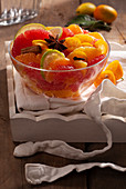 Mixed citrus fruit salad with honey and star anise