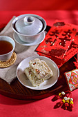 Crunchy rice candy and tea (China)