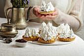 Tartlets with cream and meringue icing