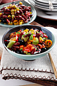 Colorful salad with red beans, pepper, olives, celery, radish and cherry