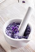 Sugar made from violet petals in a mortar