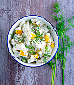 Kohlrabi salad with egg and dill