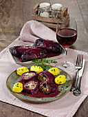Two stuffed red cabbage roulade with boiled potatoes