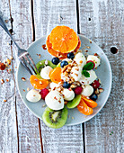 Mozzarella fruit salad with chopped nuts