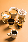 Different classic kinds of coffee drinks served in cups of various sizes
