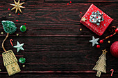 Wooden background with packages and christmas decorations
