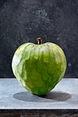 A cherimoya against a dark background