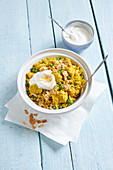 Spicy pilaf with chicken, peas and almonds