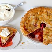 Strawberry rhubarb pie with cream