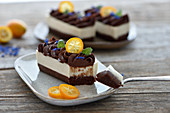 Raw vegan chocolate orange nougat tartlets with almond base