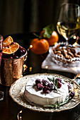 Brie with sugared rosemary and cranberries