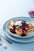 Crepes with blueberry sauce and yoghurt