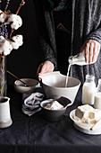 Pouring milk on bowl