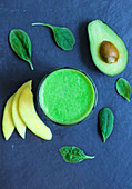 A green smoothie made from avocado, spinach and mango