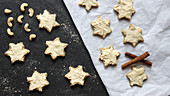 Vegan cinnamon stars made from apple and hazelnut dough with a cashew nut frosting