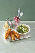 Breaded chicken fingers with fennel salad