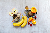 Ingredients for alkaline muesli – berries, bananas, oranges and apples