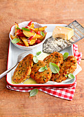 Schnitzel in parmesan crust and oven vegetables
