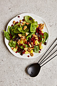 Spinach salad with beetroot, cranberries and walnuts