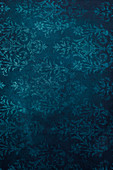 Dark blue background with floral pattern