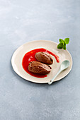Chocolate mousse with strawberry puree