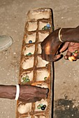 Datooga men playing Mancala