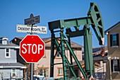 Oil well and pump jacks near housing developments