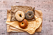 Selection of bagels on brown paper bags