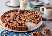 Walnut tart with cinnamon, sliced