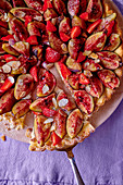 Fig tart with strawberries and flaked almonds