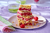 Several pieces of raspberry crumble cake, stacked