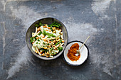 Pasta salad with chickpeas, green beans, olives and walnuts