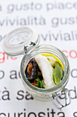 Pickled sole with mussels in a glass jar