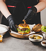 Arrange roasted onions on cheeseburger