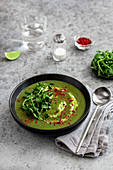 Spinach soup with chilli flakes and watercress