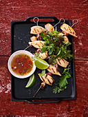 Calamaretti kebabs with nuoc-cham dip and herb salad