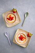 Coconut and orange rice pudding with strawberries