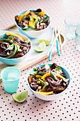 Vegan black rice noodle salad with mango and tempeh