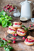 Mini choux pastry rings with raspberries and vanilla buttercream