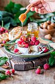 Camembert cheese with raspberries