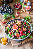 Raspberry fig salad with grapes, honey comb and raspberries
