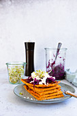 Carrot flatbread with red cabbage salad, feta and radish sprouts