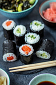 Home made sushi maki with cucumber and salmon