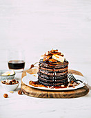Chocolate pancakes with caramelized bananas and hazelnuts
