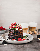 Chocolate pancakes with raspberries for Valentine's Day