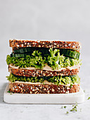 Wholegrain bread with hummus, lettuce, cucumber and cress