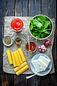Ingredients for cannelloni with quark, spinach and dried tomatoes