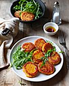 Fried sweet potato pancakes with rucola salad