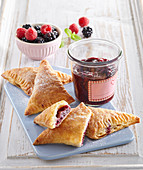 Custard pastries with forest berry jam