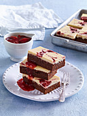 Fancy cakes with strawberry sauce